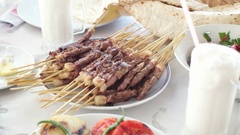 Hot roasted meat shish kebab with skewer on plate with Ayran drink Stock Footage