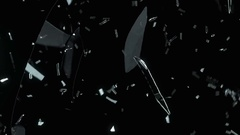 Pieces of destructed Shattered glass in slow motion. Alpha matte Stock Footage