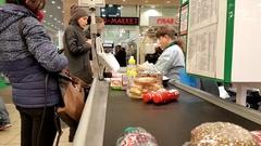 Cashier serves customers in a supermarket Okei Arkistovideo