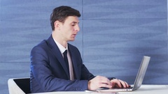 Young Businessman Stunned After Reading Something Stock Footage