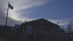 Western house and a Canadian flag in the evening. Stock Footage