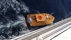Pilot boat retrieving pilot 4K Stock Footage