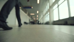 Two people going with suitcase in modern airport terminal Stock Footage
