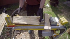 Man chopping wood with a special device Stock Footage