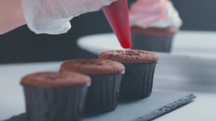 Slowmotion. Cooking cupcakes. Cupcakes with stuffing Stock Footage