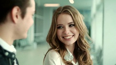 Close up faces of two business people talking and smiling. Stock Footage