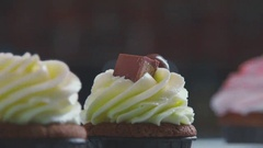 A freshly made cupcakes decorated with chocolate and biscuits Stock Footage