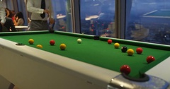4k, Business colleagues playing pool or billiards after work in the evening.  Stock Footage