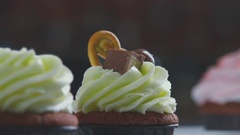 Chef decorates dessert cake. Close-up of the finishing touches Stock Footage