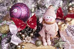 Christmas arrangement. Cheerful snowman and tree decorations. Tinted in pink Stock Photos
