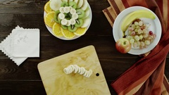 View of laying fruits on a plate Stock Footage