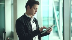 Businessman using electronic tablet Stock Footage