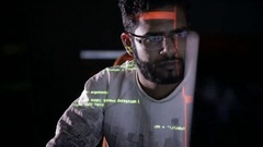 Arabic IT specialist working on computer at night. Hacker breaking computer code Stock Footage
