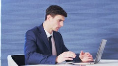Young Businessman Cannot Believe in What He Has Read Stock Footage