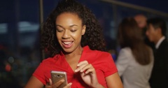 4K Woman pouting to take selfies with smartphone in city venue at night Stock Footage