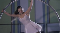 Professional circus performer rotate on cyr wheel Stock Footage