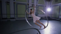 Professional circus performer rotate on a big steel ring Stock Footage
