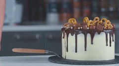 Slice of chocolate cream brownie cake topped with white chocolate Stock Footage