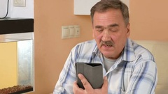 A senior man with a mustache talking on a tablet computer with relatives. He Stock Footage