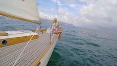 Beautiful girl friends on sailboat in ocean on luxury lifestyle happy adventure Stock Footage