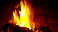 Bright, orange flames over burning logs. Slow Mo. 1 Minute, 24 fps Stock Footage