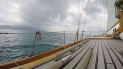Wooden luxury sailboat sailing over ocean in beautiful blue mediterranean sea Stock Footage