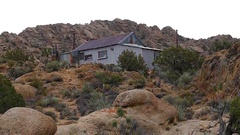 Zoom Out - Abandon House - Riley's Camp - Mojave Desert California Stock Footage