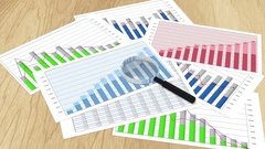 Financial charts, graphs, statistics and magnifying glass on table, presentation Stock Footage