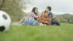 4K Happy young Asian family having a picnic outdoors in the countryside Stock Footage