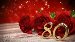 Seamless loop birthday background with red roses on wooden desk. eightieth Stock Footage