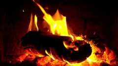 Burning fire wood in the brick furnace. Zoom out, 30 fps footage Stock Footage