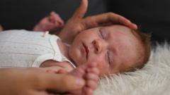 Cute newborn baby girl sleeping Stock Footage