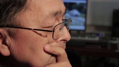 Asian man thinking matters and getting down to work Stock Footage