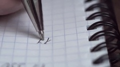 Pen writes a letter on paper. Closeup. Shallow depth of field Stock Footage