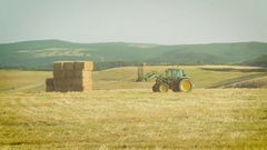 Farmer at work in the fields with the tractor Stock Footage