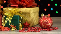 Beautiful Christmas gift boxes and decorations on a wooden floor against Stock Footage