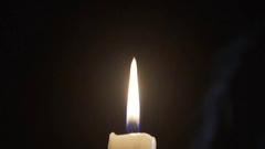 Candle Flame Being Relit From Its Smoke Stock Footage