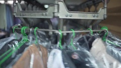 Clothes Spinning in Mechanical Hanger at Dry cleaner Stock Footage