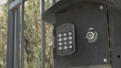 Person push buttons on a panel of intercom system Stock Footage
