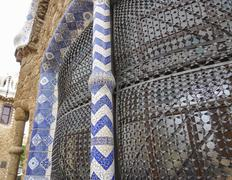 Typical mosaic decoration on the buuildings at Park Guell Stock Photos