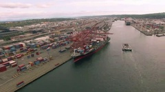 4K aerial view turn around downtown Seattle container ship port Stock Footage