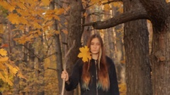 A girl with long loose bright brown, almost ginger, hair and a few locks in the Stock Footage