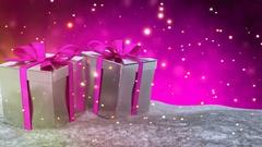 Christmas gifts in snow on pink bokeh background. Seamless loop. 3D render Stock Footage