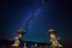 6K Astro Timelapse of Galaxy over Symmetric Radio Observatories  Stock Footage