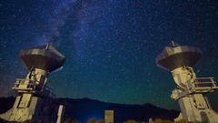 Astro Timelapse of Galaxy over Symmetric Radio Observatories -Long Crop- Stock Footage
