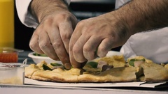 Chef puts green spinach on a pizza. Pizza cooking Stock Footage