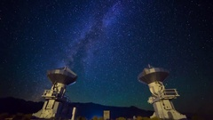 Astro Timelapse of Galaxy over Symmetric Radio Observatories -Zoom In- Stock Footage