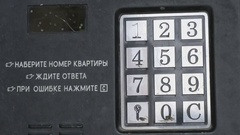Hand dials number of apartment on intercom system Stock Footage