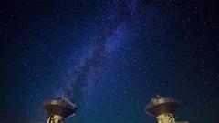Astro Timelapse of Galaxy over Symmetric Radio Observatories -Tilt Down- Stock Footage