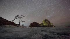 4K. Starry night over the island Olkhon. Burkhan Cape, Olkhon island, Lake Ba Stock Footage